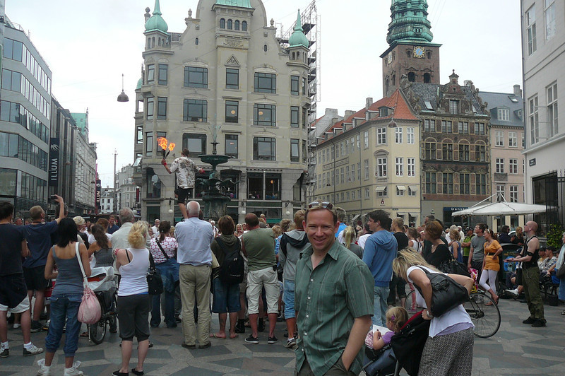 """There's Shawn taking in some of the action on the """"Stroget""""... Copenhagen's famous pedestrian only Shopping area... no trip to Copenhagen would be complete without a little people watching on the """"Stroget""""! :-)"""