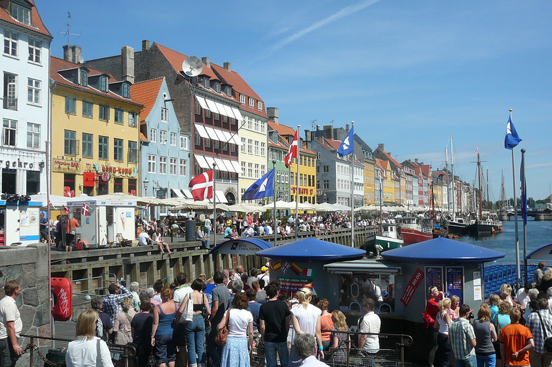 """Here's the famous Nyhavn district of Copenhagen. Here you will find street cafes, pubs and a wide selection of dining experiences including the must have """"Smorrebrod"""". (Open faced sandwich)"""