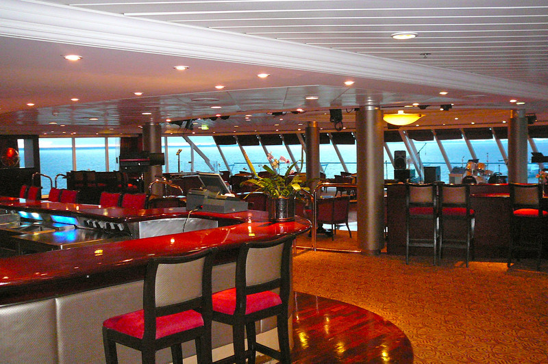 "Here's one of the best spots on the ""Journey"" to hang out whether it's daytime or night... the ""Looking Glass"" Lounge. During the day it's the perfect spot to view the Beautiful scenes as you sail the ""Seven Seas"" and at night it's the nightclub to dance and socialize in till the wee hours of the morning!"