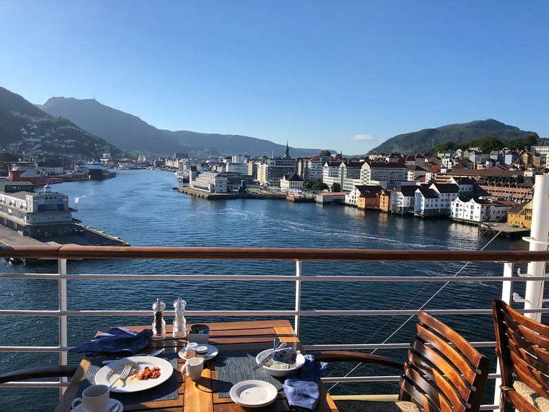 "After enjoying a day at Sea for the 1st day of our sailing (as our Cruise started/ended in London we had a nice relaxing ""Sea Day"" at the start & end of our Cruise which is the best way to do it!) our 1st port stop in Norway was in Bergen... as you can see from our breakfast table on the back deck of the Serenity we had a pretty scenic ""first taste"" of this Beautiful country!! :-)"