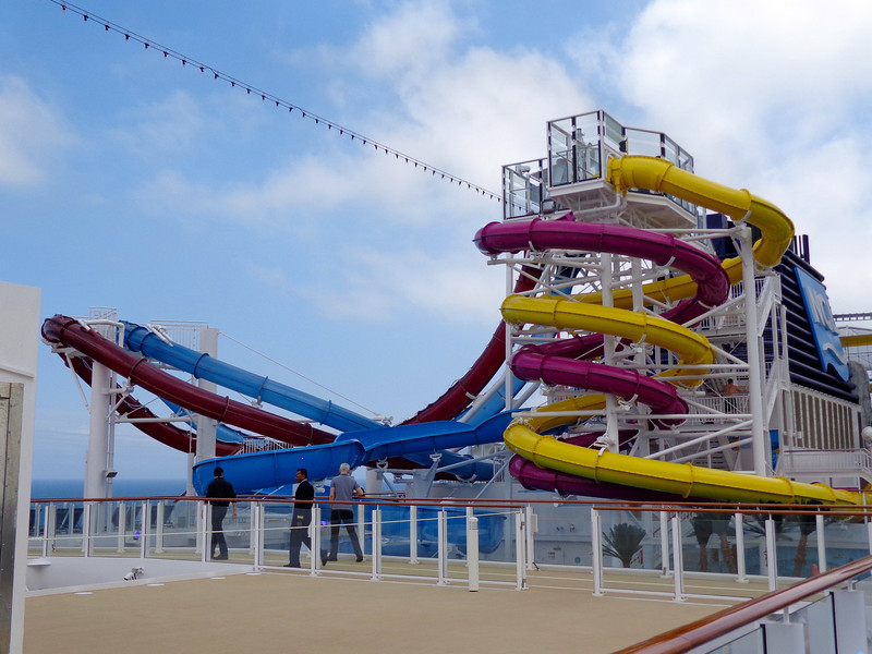 Now whether you're young or young at heart you're going to love this area of Breakaway... 5 slides to enjoy during your sea days and a couple of them are even dueling racing slides and others feature huge vertical drops!