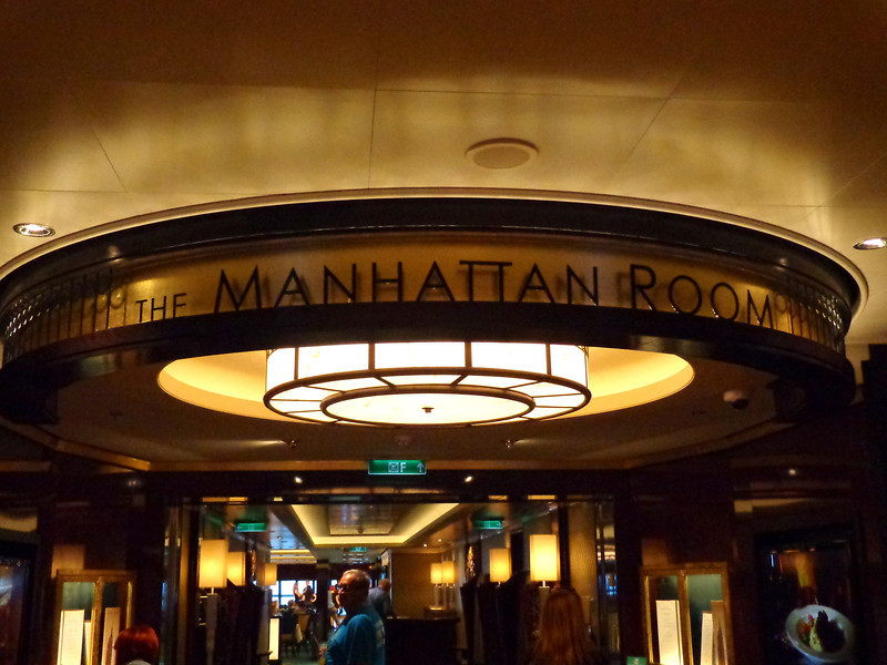 "There's a look at the entrance to the ""Manhattan Room"" (we mentioned the ship is New York themed, right? :-)) which is the main complimentary dining room and it's also where you'll see the famous ""Burn The Floor"" Ballroom dancers perform."