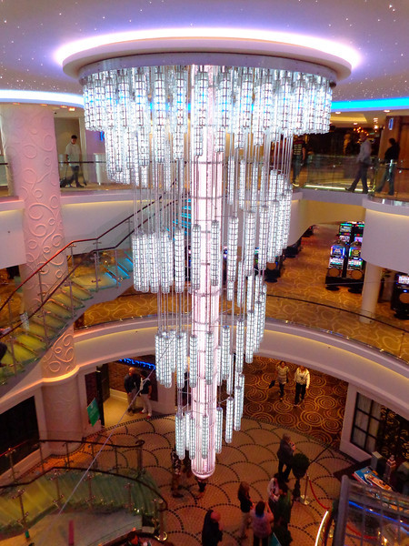 "There's a peek at the gorgeous LED chandelier that hangs down in the impressive ""678 Ocean Place"" Atrium."