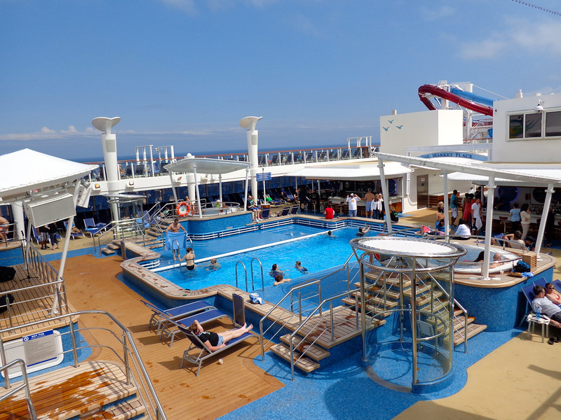 Alright, time to check out the rest of the ship that everyone gets to enjoy no matter what room you're staying in.  There's the main pool area with hot tubs along-side... great for a sunny day in the Bahamas or Bermuda!!
