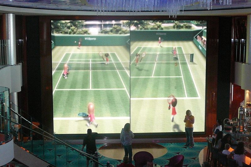 """For those of you who know """"Nintendo Wii"""" this is NCL's version of Wii on Steroids!! Check out the action on the Atrium's 2 Storey Big Screen!!"""