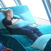 "Shawn caught Nancy ""Lounging"" in ""Spinnaker"" on Deck 13. This is a great place to read, relax, check out the Oceanviews and if you're game, NCL's ""Speed BINGO"" was held up here!! :-)"