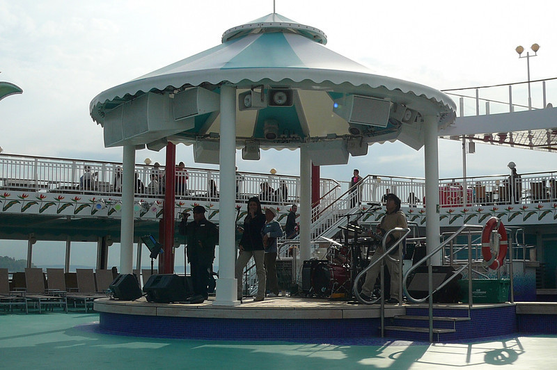 "What Cruise would be complete without your Traditional ""Pool Band"". :-) Not hard to tell by the way they're dressed though that it's early May and we're not in the Caribbean!! :-)"