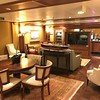 "If you clicked on the link in an earlier video that showed you all the perks you get when staying in a Suite you may have read about getting access to the ""Executive Lounge""… here's a shot of what that looks like inside.<br /> <br /> We enjoyed some time in there on several occasions as it's a quiet place to go check out the day's menu for all the restaurants as well to grab a snack, a beverage, etc. or to chat with the Suite Concierge about any issues onboard, assistance you need off of the ship, etc."