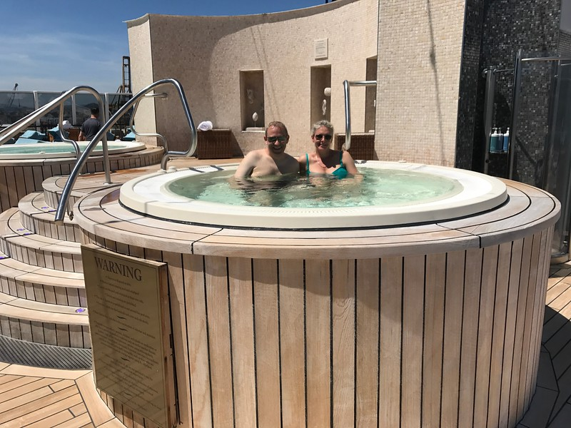 """And 2 hot tubs away from the main pool area crowds! :-)<br /> <br /> We have to say, this was our 2nd time on """"Marina"""" and it was even better then the first time as the food onboard has gotten better & better and staying in a Suite really enhanced our Cruise with the 50% extra space and all the extra perks, especially our Butler Sam who made our trip extra special.<br /> <br /> Some people say, """"A Butler, that's a bit pretentious, isn't it?"""" Not at all, they're simply there to do the nice little things that make your trip extra special… like every morning he'd deliver Nancy's coffee at the same time and give us the weather repot for the day… he'd have what drinks we wanted in the room daily, brought our room service orders just the way we liked them, set up a get-together in our Suite with friends for a pre-dinner drink, etc. Overall he made our Cruise more awesome!<br /> <br /> Well, all we can say is if you've only ever experienced big ship cruises you've got to try an """"Upper-Premium"""" line like Oceania, Azamara or Viking or a """"Small-ship All-Inclusive Luxury"""" line like Regent, Crystal, Silversea or Seabourn as they're truly a different world from the big ships and they make for extra special Cruise vacations!! :-)"""