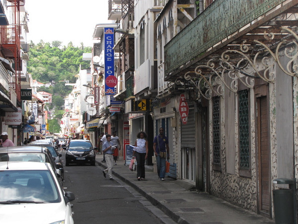 """Just like in the real France, and much of Europe, Fort de France has the cool little bustling side streets where you can shop, eat & people watch... and where they can only fit those tiny little European cars... you don't see many big SUVs here. :-) Check out our full review of our Cruise here: <a href=""""http://nancyandshawnpower.com/12-night-southern-caribbean-cruise-oceania-marina/"""">http://nancyandshawnpower.com/12-night-southern-caribbean-cruise-oceania-marina/</a>"""