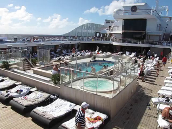 "As mentioned, Oceania is considered to be an ""Upper-Premium"" Cruiseline... check out this video of the pool area to get a feel of the difference between a smaller, more luxurious ship like this compared to a mainstream ""big-ship"" Cruise."