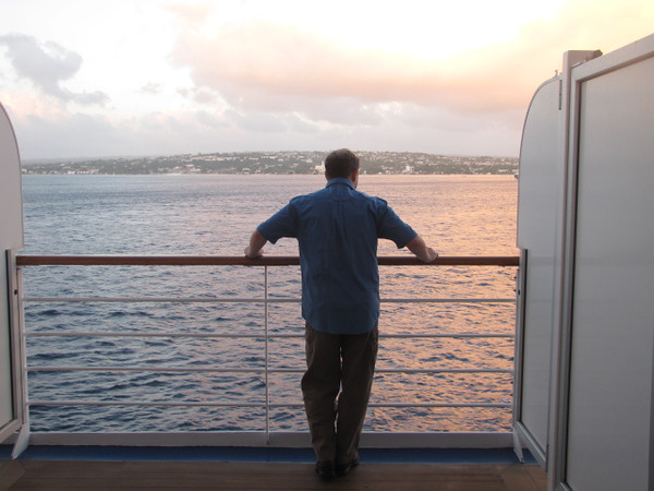 There's Shawn enjoying the views of Barbados from our private verandah as we sailed away from this friendly island... the people were super nice there! :-)