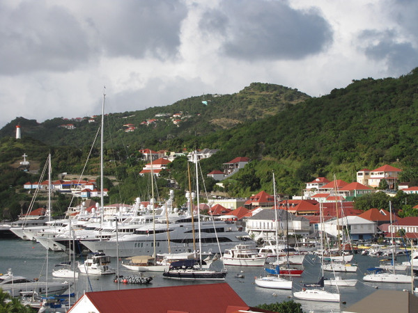 There's a peak at just a few of the boats & yachts that line Gustavia Harbor... and check out those hillside homes... nice! :-)