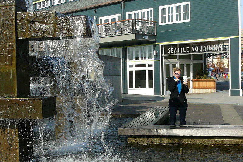 "At the end of our Cruise we figured, why not enjoy the Beautiful city of Seattle for a day!! There's Nancy showing off Seattle's famous export ""Starbucks"" outside the Aquarium. :-)"