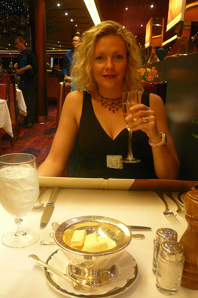 "There's Nancy enjoying a glass of Champagne & getting ready for Dinner # 2 on the ""Oosterdam"" in the ""Vista Dining Room""... great food and service every-night of the week... the luxuries of the ""Cruising Life""!! :-)"