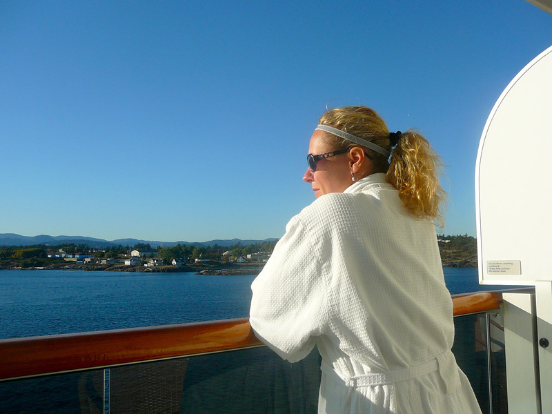 "There's Nancy enjoying the views as we ""sail away"" from Victoria... a robe, views from your Private Balcony Stateroom, a great Sunny day, not much else you could ask for on a great Cruising day like today!!"