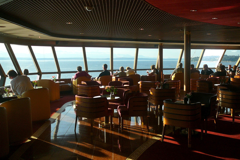 """There's a shot of the Observation Lounge, """"The Crow's Nest"""", at the very front of Deck 10... a great place for viewing as the """"Oosterdam"""" travels the """"Seven Seas""""!"""