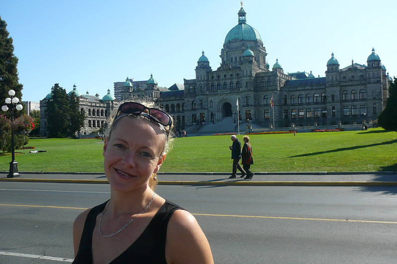 "As we were in Victoria just last week when on our ""Regent"" Cruise to Alaska, we just got off for a little stroll around today... as you can see from Nancy's smile & her light clothing we were treated to another Gorgeous day!  Isn't the Parliament Building behind her pretty... & Nancy's pretty cute too! :-)"