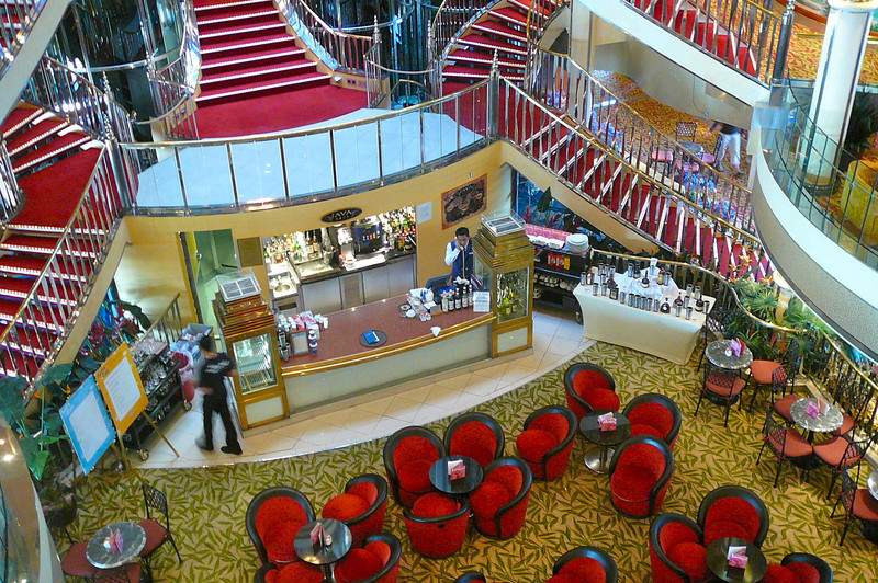 We mentioned the Atrium being a Beautiful one... here's a glimpse of her from high above... one of the most popular features is the Coffee Bar seen in this pic... not too busy now as everyone's in Victoria but a happening spot to socialize and people watch when at Sea!