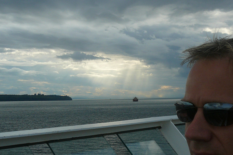 "Check out those ""rays"" hitting the Pacific Ocean behind Shawn as we sail from Vancouver... if today is an indicator of how the rest of our Cruise is going to go it's going to be one Beautiful week!!"