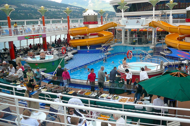 "There's a glimpse of the Pool area on the ""Star""... for our ""Sail Away"" party they had a big BBQ on the open deck... very nice!! :-)"