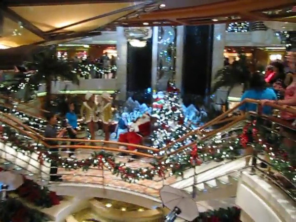 "When we told our Family & Friends we were cruising at Christmas they wondered would we miss the decorations, Christmas Spirit, etc.  Well, in this footage you'll see Santa, Snow Falling, Santa's helpers, etc.  You definitely don't miss out on anything during Christmas ""at Sea""! :-)"