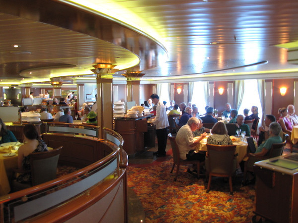 """Now there's one of our favourite areas on the """"Coral"""" and all the Ships we sail on... the Main Dining room!! :-)  Here's where'll you'll enjoy (included in your Cruise fare) 5 Course Fine Dining meals each evening served by 2 gracious waiters... and the Menu changes every night... Delicious!! :-)"""