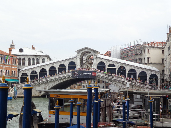 "Cutting right through the heart of Venice is it's main waterway, the ""Grand Canal"", and there's the ""Rialto Bridge"" which is the oldest & main bridge that crosses the canal."