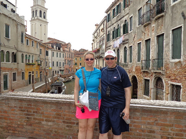 What do you think... r we looking Happy to be in Venice! :-) We've had this place on our bucket-list for quite sometime and she certainly didn't disappoint... isn't that setting behind us just what you picture when strolling around Venice! :-)