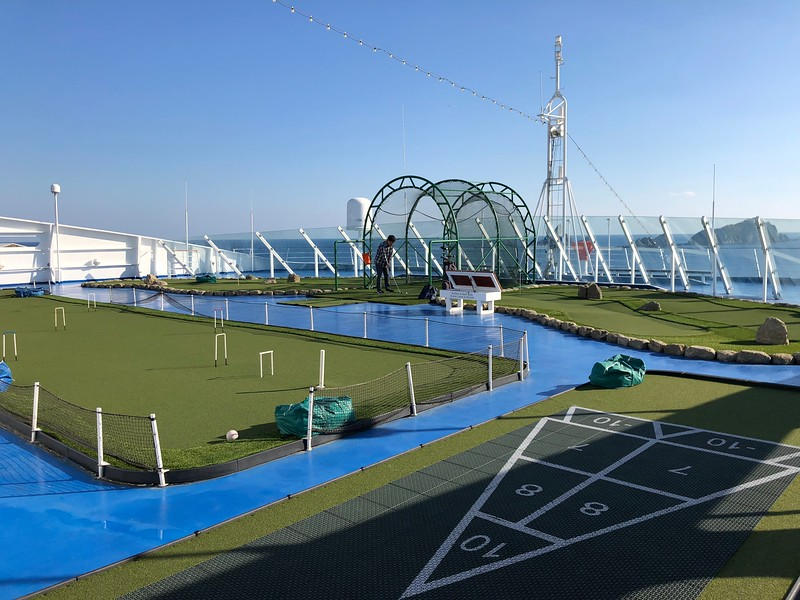 Or on the top deck there's a golf net, putting green, croquet, shuffleboard, paddle tennis, a jogging track, etc. to keep you busy.