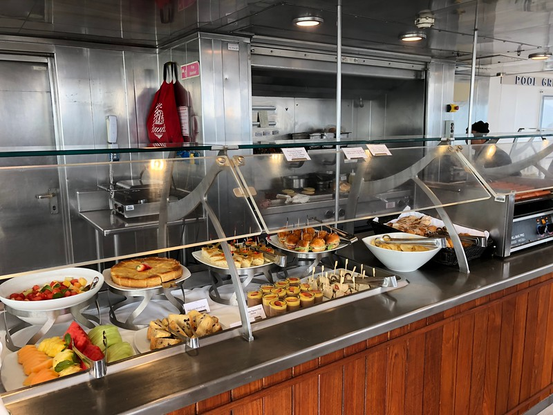 """WOW, that's a lot of food options, right? Well, we're not done yet! Here's a picture of the """"Pool Grill"""" where you can get """"Black Angus"""" Burgers, Seafood Burgers, Veggie Burgers, Hot Dogs, Sandwiches, the BEST Sweet Potato Fries, etc."""