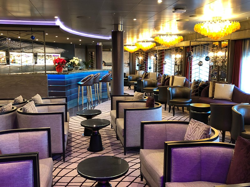 """Nor, will you ever have to worry about finding a place onboard to enjoy a """"Social"""" beverage or two. (or three) Whether it's at the outside pool bar or at the above """"Voyager Lounge"""" or at the…"""