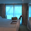 "Here's a look at a middle deck Category 2 ""French Balcony"" stateroom (Category 3 is the same as this one)... as you'll see it's almost identical to the room we stayed in except that it doesn't have the separated ""Solarium"" area where the window opens. We loved our room as some mornings one of us were up before the other (or some afternoons only one of us took a nap) so you could go out, close the curtain and read a book, etc. without disturbing the beauty sleeper. :-) Either way these rooms are identical size to the top deck but if you like the separated feel and the better views (on this deck you're only 2-3 feet above the water so you don't see as well up over the River banks) move up to the top deck, Category 1 room."