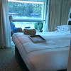 "Let's have a peek around the ship before we show you what our itinerary was like… here's a ""Live"" look at what our top deck, Category 1 ""Open-Air Balcony/Solarium"" stateroom was like. The nice feature we really enjoyed with this room is that the glass doors between the bed and where Nancy is sitting can be pulled across as can the drapes so it separates the room from the Balcony so one partner can enjoy the balcony while the other is catching up on a little rest. :-)"