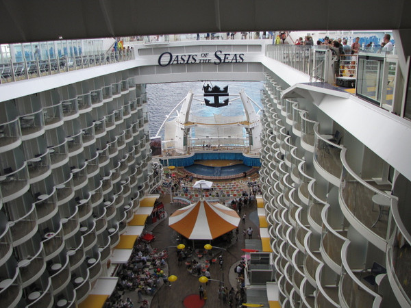 "We love this picture... you really get a sense of how unique and one-of-a-kind this ship is. Here you see the balcony staterooms looking down into The Boardwalk and far to the back you can see the outdoor ""Aqua Theatre""."