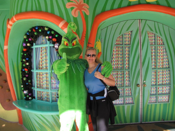 """The Grinch is one of Nancy's favorite movies so she couldn't pass up a shot with """"The Grinch"""" himself!!  Anytime we Cruise from Florida we love going to Universal or Disney before or after... Fun, Fun, Fun!! :-)"""
