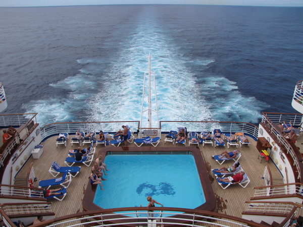 "The ""Crown Princess"" had 4 pools onboard but this one at the back of the ship was definitely one of the nicest... it's quiet, there are pretty much adults only back there and you get to enjoy the soothing ""wake"" of the Ocean!"