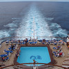 """The """"Crown Princess"""" had 4 pools onboard but this one at the back of the ship was definitely one of the nicest... it's quiet, there are pretty much adults only back there and you get to enjoy the soothing """"wake"""" of the Ocean!"""