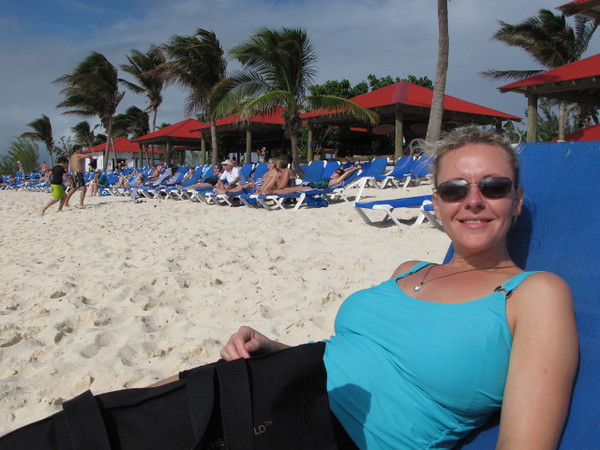 "There's Nancy enjoying one of her favorite activities... ""lounging"" on a beach! :-)"