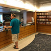 Any questions about the ship, help needed with your room, your onboard bill, etc. you can visit the reception area 24hrs per day... and if you look to Shawn's right you'll see they have lots of movies available as well if you want to enjoy one in the privacy of your Stateroom or Suite.