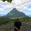 "Like in Bora Bora we rented a car to circle the whole island (this one was a bit bigger, about 1.5 hrs around and we did need to get some gas here :-)) and were happy we did as we saw some great scenery like ""Cook's Bay"" and ""Opunohu Bay"" behind Shawn from Belvedere lookout."