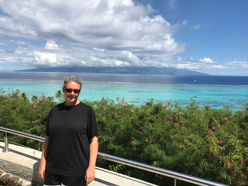 There's Nancy checking out some of Moorea's pristine waters... FYI, that's Tahiti in the background where we flew into Papeete to start our Cruise and where it ends.