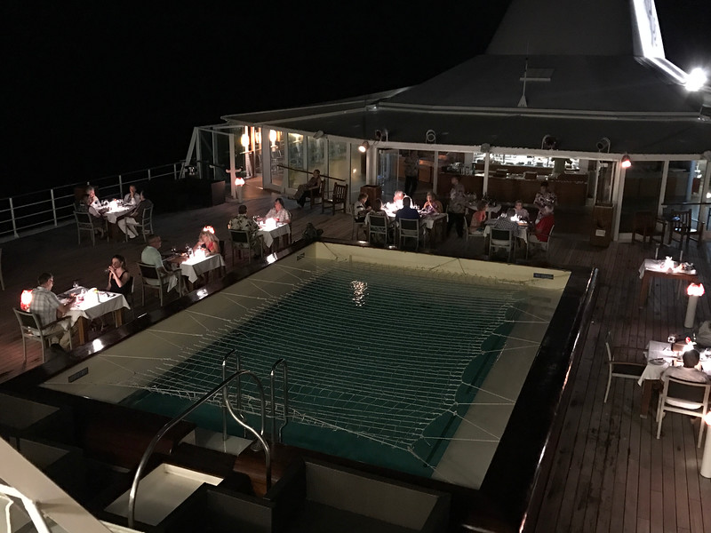 "FYI, on select nights (usually when over-nighting in Bora Bora & Moorea) they put the tables at ""Le Grill"" outside on the pool deck... if you like the sound of that option see the Maitre'd right away when onboard as this option fills up fast!<br /> <br /> FYI # 2, even though ""Le Grill"" & ""La Veranda"" are considered specialty restaurants in the evening & are reservations only there's NO charge to dine at either, unlike on the mass market cruises that typically charge $45 per person or more for unique dining experiences like these."