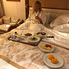 Even though the 3 restaurants we just showed you serve super yummy food sometimes you may be just too lazy to get dressed up for dinner after a long day of enjoying tours/hanging in the sun at the beach, etc. <br /> <br /> No worries, you can get cozied up like Nancy above and order from the 24 hour room service menu... FYI, during evening dining hours you can also order off the Main Dining Room, L' Etolie's, Menu.
