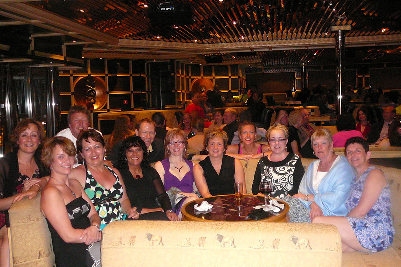 "There's a bunch of our Group enjoying their time together at the ""Captain's Party""... it was so cool for us bringing everyone together for a fun Cruise :-)"