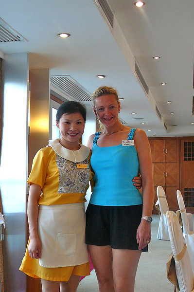 There's Nancy posing with Coco, one of the great Waitresses who took care of us on our Cruise!  You're right, that's not her real name... they all have English names to make it easier for us westerners. :-)