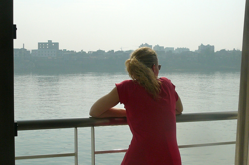 "There's Nancy enjoying some of the other great ""Yangtze River"" views from our Private Balcony Stateroom."