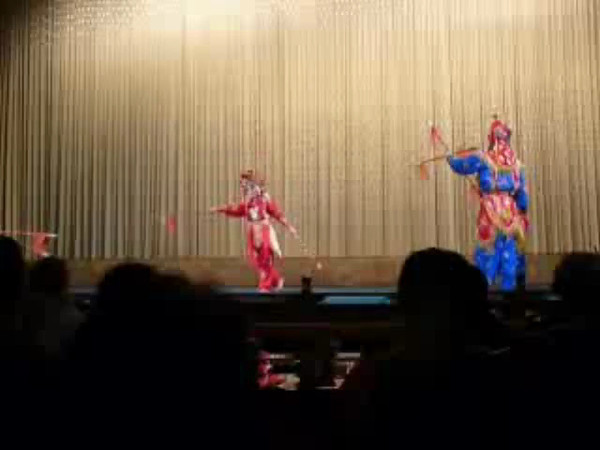 "The Famous Beijing ""Peking Opera"" is a combination of music, martial arts, etc.  Here's a Video Clip to give you a glimpse of what to expect."