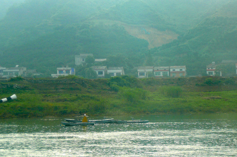 "There's a glimpse of one of the many towns you'll see while sailing the ""Yangtze""."