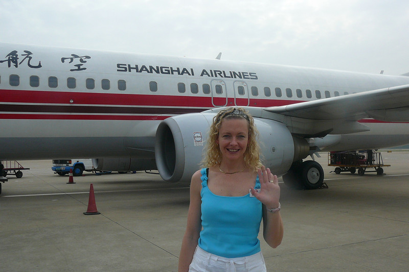 "During our Tour we had 3 Intra-China flights so we got to check out a few of China's airlines... here's Nancy getting ready to board our ""Shanghai Airlines"" flight from Shanghai to Wuhan."